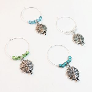 Peacock Gifts includes 4 wine charms surround by blue turquoise and silver beads