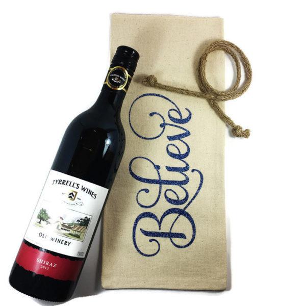 christmas wine bag says Believe