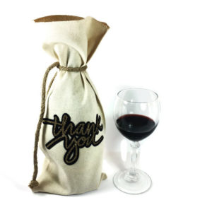 wine bag with rope jute tie, thank you on front in gold glitter and black background