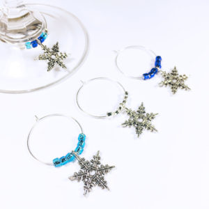 set of 4 snowflake wine charms surrounded by blue and silver glass beads