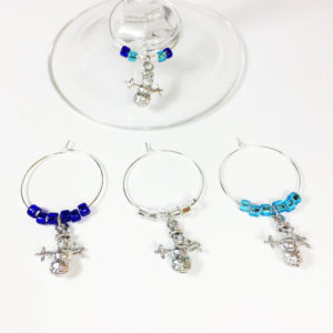 set of 4 snowman wine charms surrounded by cobalt blue, light blue and silver glass beads