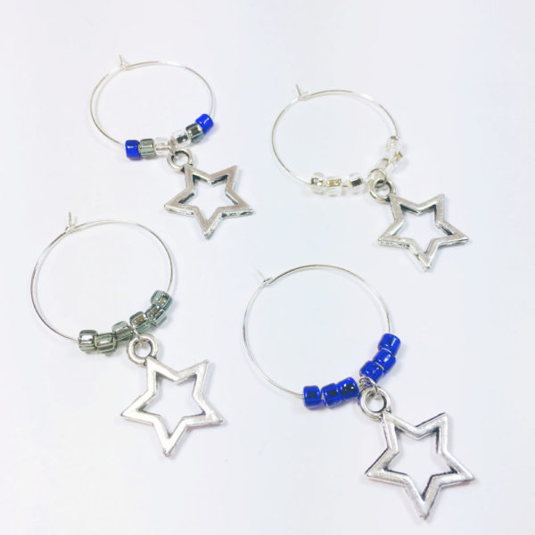Set of 4 Dallas Cowboys Wine Glass Tags surrounded by blue, silver and gray beads