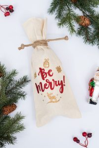 red and gold christmas wine bag