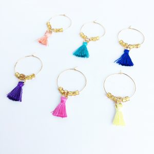 gold wine glass charms with colorful tassels