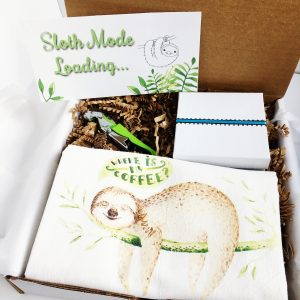 gift box with sloth kitchen towel sloth wine charms and green metal wine opener