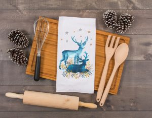 christmas tea towels featuring blue deer with silver and gold accents